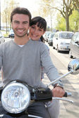 Couple on scooter — Stock Photo