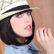 Stock Photo: Sexy womwith straw hat and denim shirt