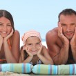 Family relaxing at the beach — Stock Photo #7362181