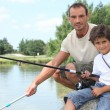 Father and son on a fishing trip at a lake — Stock Photo #7362269