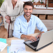 Happy doing accounting at home — Stock Photo #7362376