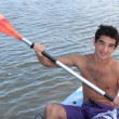 Stock Photo: Young lad kayaking