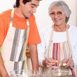 Grandmother and grandson cooking together — Stok fotoğraf
