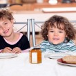 Stock Photo: Little girls having snack