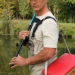 Fisherman with rod and tackle box — Stock Photo #7362951