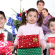 Parents and children at Christmas time — Stock Photo