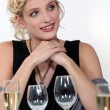 Royalty-Free Stock Photo: Woman drinking champagne at dinner
