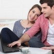 Couple with a laptop — Stock Photo