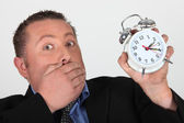 Man shocked to discover the time — Stock Photo