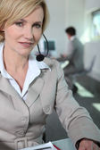 Woman with headset. — Stock Photo