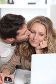 Husband kisses wife on the cheek. — Stock Photo
