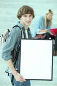 Student holding white board — Stock Photo