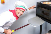 Pizza maker at work — Stock Photo
