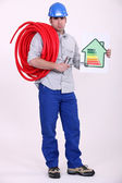 Electrician holding energy rating placard — Stock Photo
