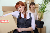 Young women on moving day — Stock Photo