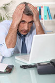 Stressed man using laptop — Stock Photo