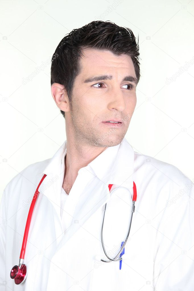 Isolated shot of a worried looking doctor — Stock Photo #7361302