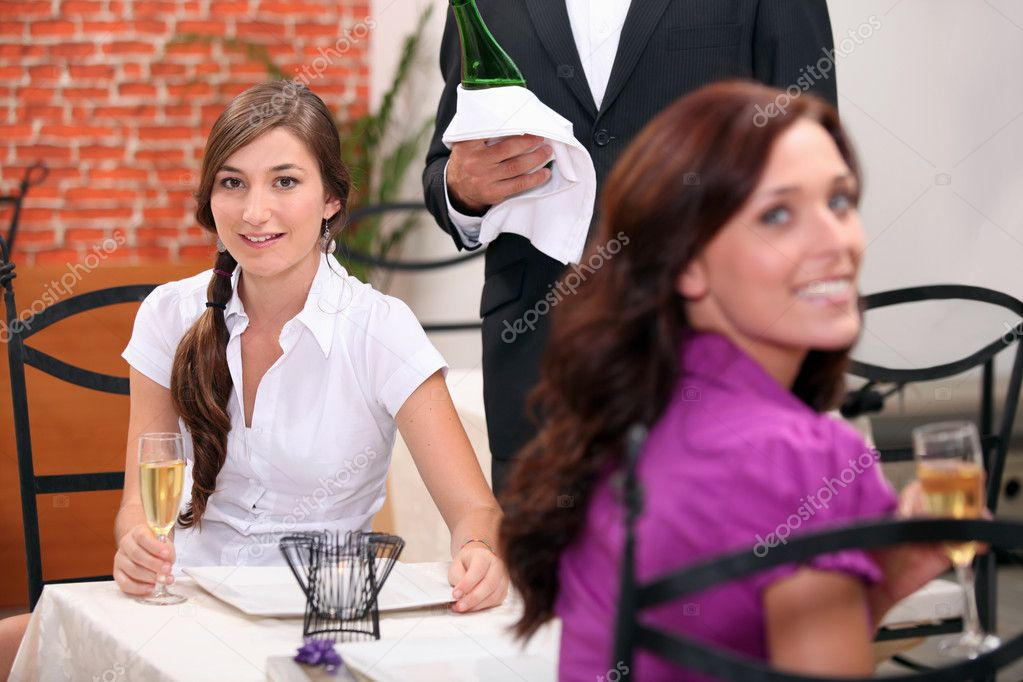 Two women drinking sparkling wine at restaurant — Stock Photo #7362648