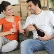 Couple drinking champagne at home - Stockfoto