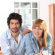 Couple having coffee in kitchen — Stock Photo #7372943