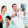 Stock Photo: Medical team discussing xray