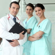 Doctor and his nursing team — Stock Photo