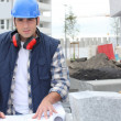 Stock Photo: Construction worker looking at his plans