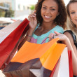 Two friends with shopping bags — Stock Photo #7374327
