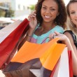 Stock Photo: Two friends with shopping bags