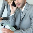 Stock Photo: Executive on cellphone