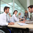 Stock Photo: Man in wheelchair working in an office