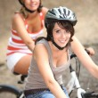 Two girls riding bikes — Stock Photo