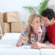 Couple lying on bed celebrating moving into new home — Stock Photo