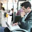 Man using laptop computer on a tram — Stock Photo #7374588