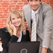 Royalty-Free Stock Photo: Smart couple with a laptop computer and cellphone