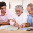 Royalty-Free Stock Photo: Family looking at a map