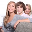 Teenagers on the sofa — Stock Photo