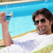 Stock Photo: Mrelaxing by pool
