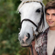 Teenager with a horse — Lizenzfreies Foto