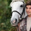 Teenager with horse — Stockfoto #7375498