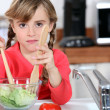 Young girl cooking salad — Stock Photo