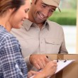 Man delivering parcel — Foto de Stock