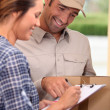 Man delivering parcel - Stock Photo