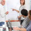Stock Photo: Group of discussing a growth chart