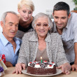 Stock Photo: Family gathered together for birthday party