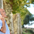Royalty-Free Stock Photo: Older man outdoors with a cellphone