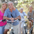 Couples riding their bikes together — Stock Photo