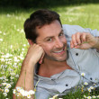 Stock Photo: Man lying in a meadow