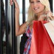Young woman entering in a store — Stock Photo