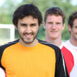 Three football players — Stock Photo